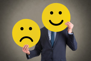 Business Person Unhappy and Happy Smileys Working